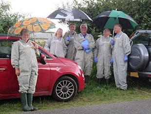 The bee inspectors and the UKAS assessment team sheltering from the rain
