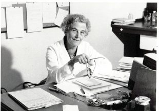 Photo of Dr Ruth Allcroft sitting at her desk.