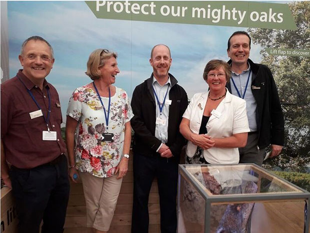 The Thursday Team – from left to right - Philip Warry, Sarah Chadwick, Carol Jackson (all APHA) and Jason Rumens (Scottish government) Chelsea Flower Show under a sign saying, 'Protect our mighty oaks'