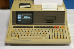 Image of a very old computer with attached keyboard.