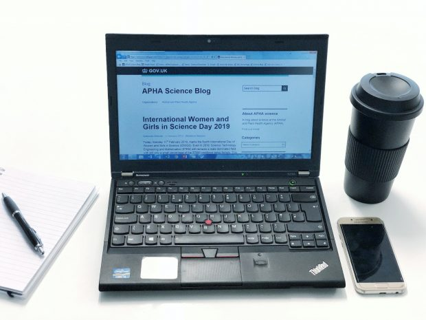 Picture of a laptop showing the APHA blog on screen, along with a coffe cup, mobile phone, pad and pen