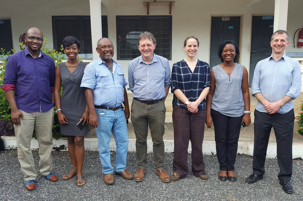 Photograph of four gentlemen and three ladies standing in a line for a photograph. They are staff from the Ghanaian Fisheries Commission with the AMR Reference Centre team.