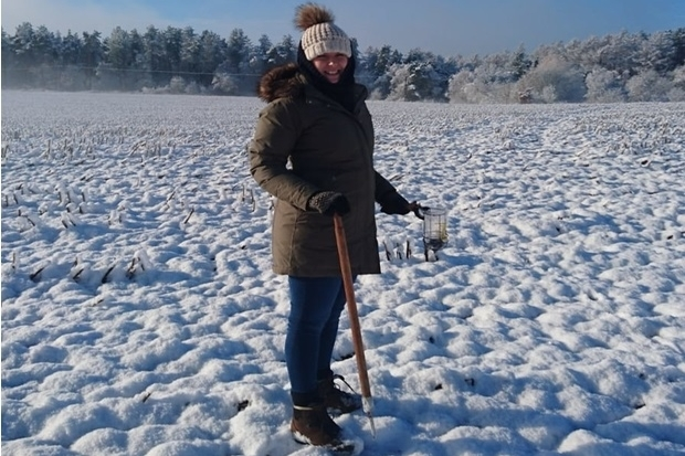 Image of Laura Chapman standing in a field covered in snow