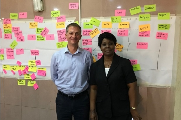 Image of Rod Card and Victoria Olusola Adetunji in front of a board of post-it notes